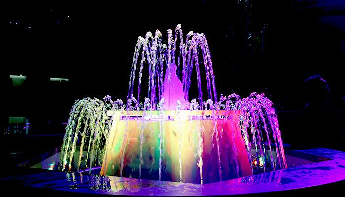 A multicolored fountain at night